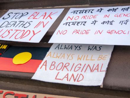 Invasion Day Rally | signs, stop black deaths in custody, no pride in genocide, always was always will be Aboriginal land, Aboriginal flag | Queensland Gallery of Modern Art